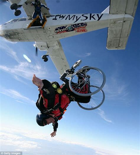 Stunt daredevils skydive on a scooter, in a wheelchair, on